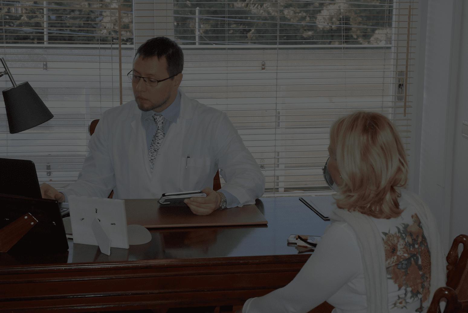Dr Spiros Vlachos Interviewing Patient